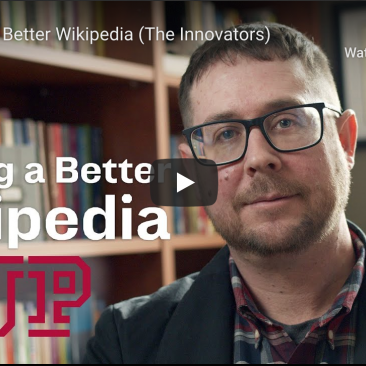 "Dr. Vetter in his office with the title ""Making a Better Wikipedia"""